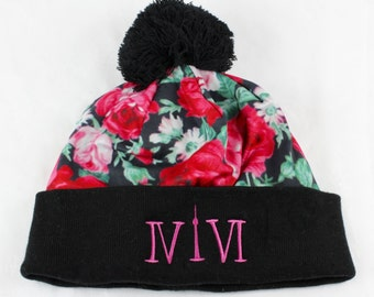 """Toronto 416 toques. The Roman Numerals Stand For 416, With The """"1"""" Resembling The CN Tower."""