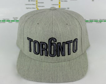 Premium Heather Grey-tness Toronto Custom Hats. 3D Raised Embroidery On High Quality Unisex Hats. 6ix, GTA, YYZ, OVO, Toronto, 416, Tor6nto
