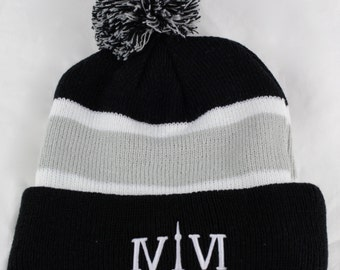 "Toronto 416 PomPom-Style Toques. The Roman Numerals Stand For 416, With The ""1"" Resembling The CN Tower."