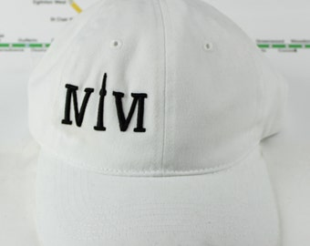 "Classic White Toronto 416 hats. The Roman Numerals Stand For ""416"", With The ""1"" Resembling The CN Tower."