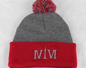 "Toronto 416 toques. The Roman numerals stand for ""416"", with the ""1"" resembling the CN Tower. We are Toronto Beautiful."