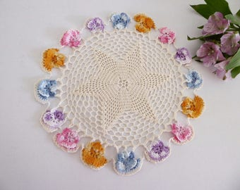 Vintage crocheted doily with pansies