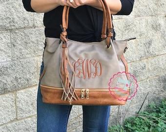 ac9508bd55bc Kara Monogram Tassel Zip Top purse
