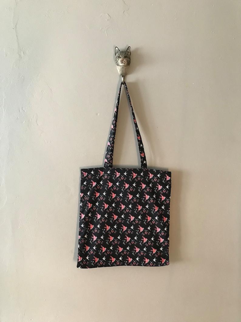 black cotton tote bag with colibri