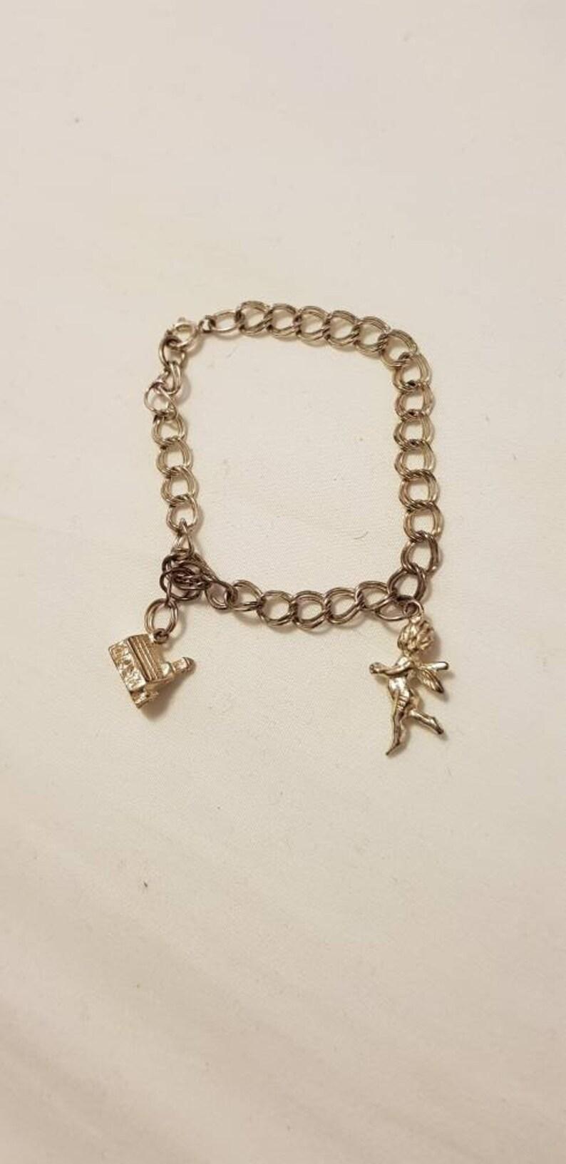 4bc0ee390294e Vintage double loop sterling silver charm bracelet 6