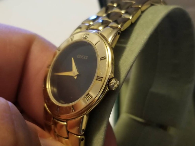 3468add003a Vintage Gucci 3300.2.L 18k Gold Plated Ladies Quartz Watch