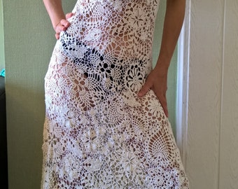 The dress is crochet, Irish lace.