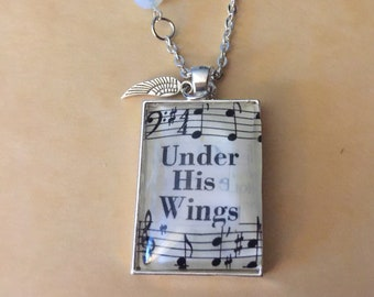 Under his wings necklace , hymnal necklace