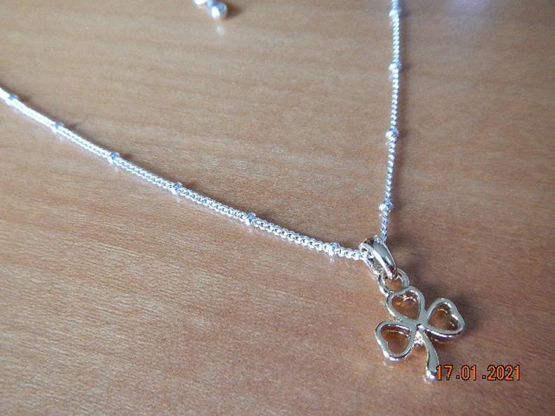 Gold-tone Shamrock Pendant on Silver-tone Necklace