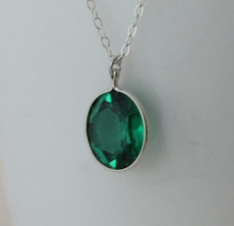 Oval Emerald Pendant on Silver Chain
