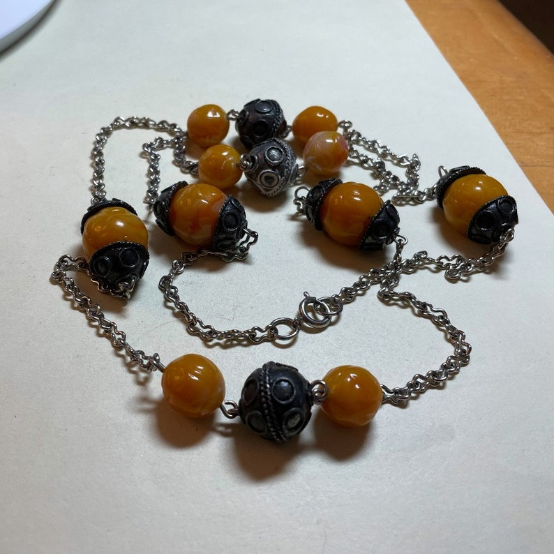 38 inches long Vintage Bali style necklace 1980s-90s beads and beadcaps orange to butterscotch plastic beads silvertone metal chain