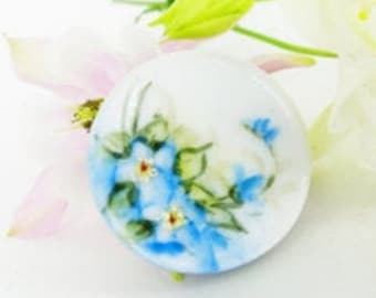 Morning glory painted on porcelain, antique upcycled as a magnetic MagTAK brooch & scarf pin with a blue leather back button.