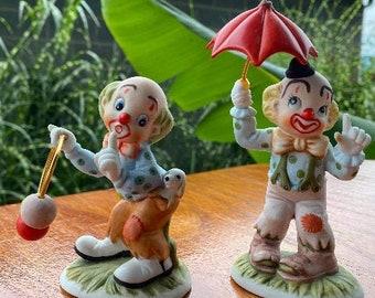 2 clown figurines