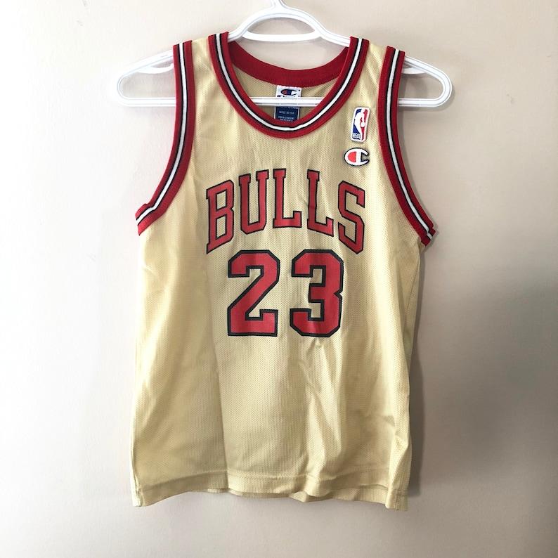 official photos 81617 a02e7 Chicago Bulls Michael Jordan Vintage Champion Gold Basketball Jersey