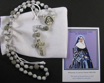 Beautiful handmade St. Marianne Cope rosary, commemorating Hawaii's second saint. Unique 100% made in Hawaii from Jobs Tears and porcelain.