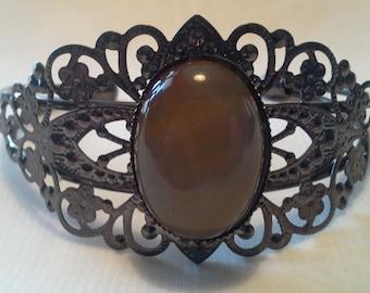 Black filigree bracelet with agate cabochon