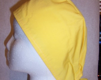 Bright yellow, fabric surgical cap.