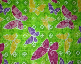"""Brightly colored butterflies on green background 100% cotton fabric (45"""" wide)  sold by(multiple lengths) #435"""