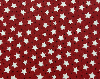 White starsand blue dots, on red background, cotton fabric. Sold by ( multiple lengths) #79