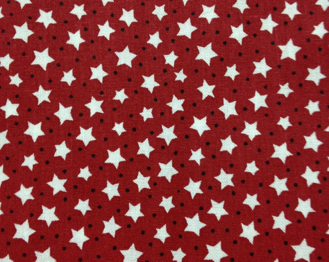 White stars and blue dots, on red background, cotton fabric. Sold by ( multiple lengths) #79