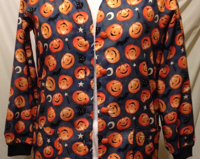 Tossed Pumpkins Halloween scrub jacket