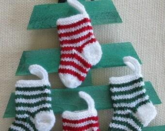 "4 TINY CHRISTMAS STOCKINGS - ornaments - 4"" long - hand knit"