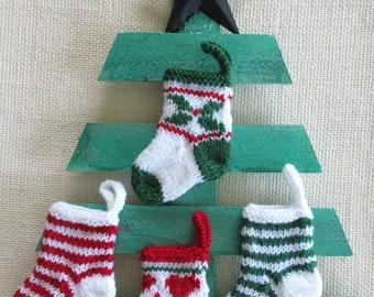 "4 TINY CHRISTMAS STOCKINGS   4"" long - hand knit"