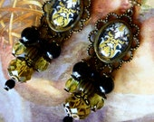Baroque earrings quot arabesques quot cabochon glass illustrated 18th, bronze metal, Bohemian glass faceted yellow green, opaque black glass