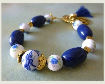 """""""Blueberry"""" gold metal, leather, flowered porcelain, blue beads, charms and tassel Navy Beads Bracelet"""