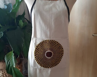 Stylish Bip Apron,  with a kiss of  African fabric on the front pocket.