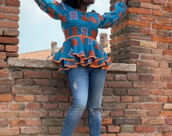 Vibrant A ruffle or flared African print Pemplum with puff sleeves
