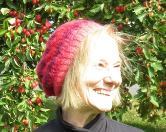hand knit lace hat: many shades of pink with a rose pattern