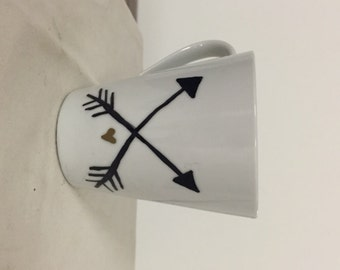 Black arrow and Mumford& Sons mug