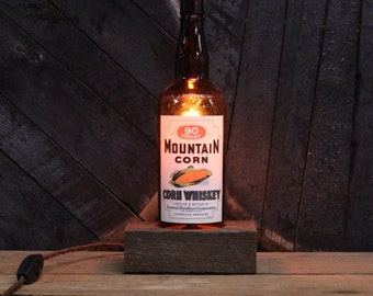 Handmade Recycled Antique Mountain Corn Whiskey Bottle Desk Lamp, Features Reclaimed Wood Base, Twisted Cloth Wire, In line Switch, And Plug