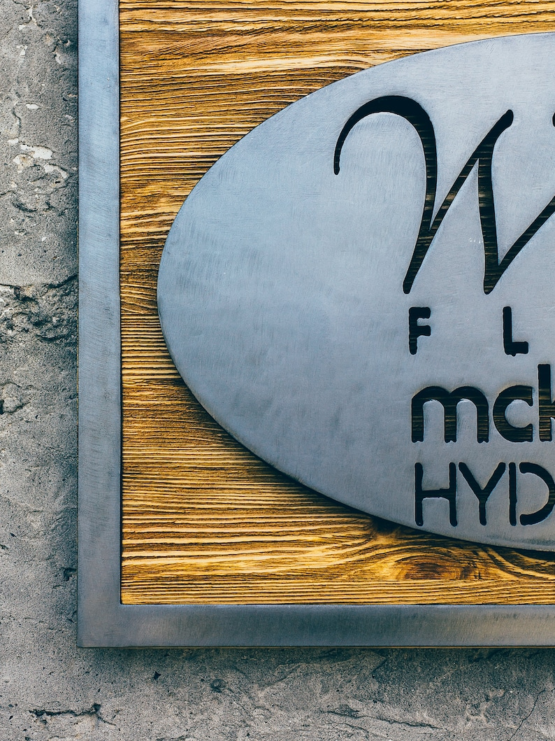 Polished metal on the reclaimed wood with a diodes Metal plaque Modern sign from wood and metal with lighting