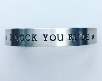 Bracelets with manually entered texts.