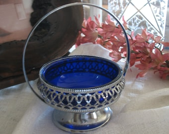 Basket has cobalt blue glass and silver plated compote.