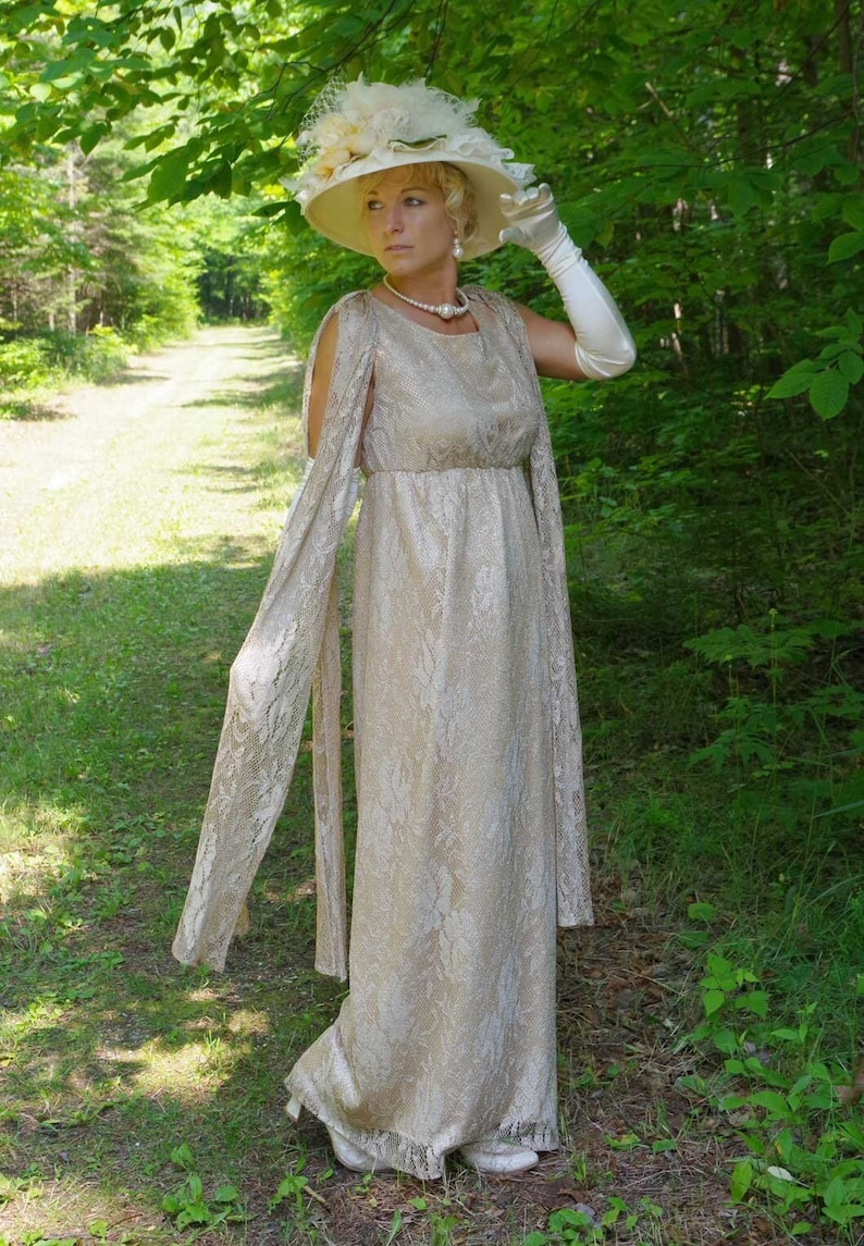 Victorian Edwardian Tea Dress and Gown Guide     Read the full title    Gwendoline Gold Lace Edwardian Dress $219.00 AT vintagedancer.com