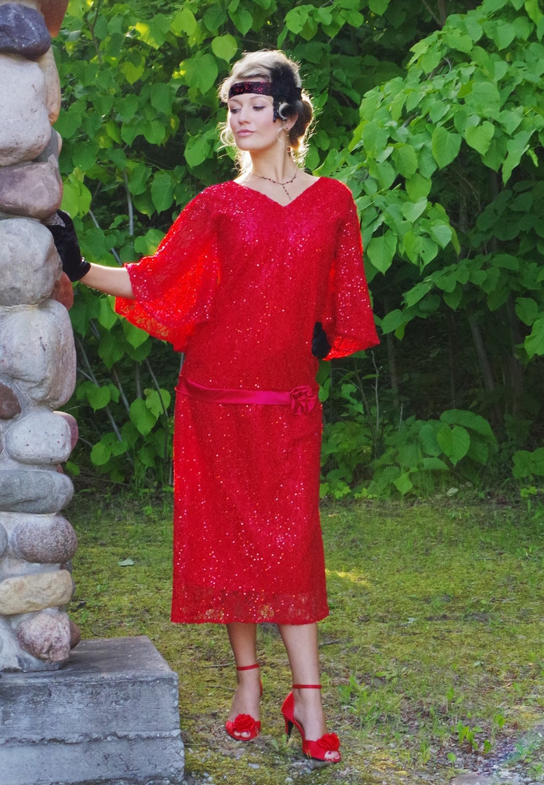 1920s Plus Size Flapper Dresses, Gatsby Dresses, Flapper Costumes 190800 Ruby Sequin Flapper Roaring 20s Dress Red Sleeves Reccollections $219.95 AT vintagedancer.com