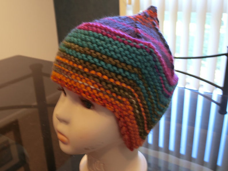 61a350ef8 Child pixie earflap hat in rainbow colors