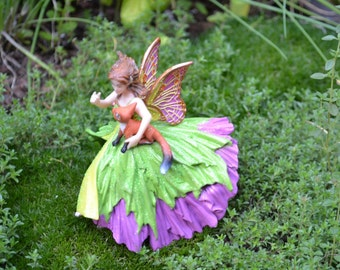 Fairy Garden Fairy, unbreakable pink and green gown, holding a baby fox