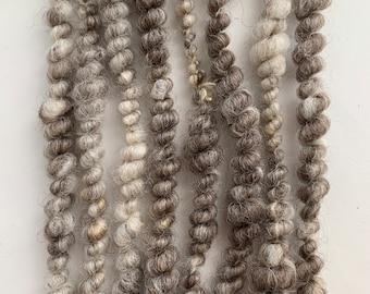 Handspun art yarn; wool, alpaca and silk blend; super bulky weight; weaving yarn; natural, undyed fibres; core spun and spiral plied