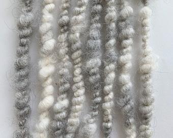Hand spun art yarn; raw undyed grey and white Australian alpaca locks core spun and plied with recycled denim yarn;  weaving or knitting