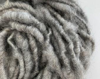 Hand Spun yarn; 100% undyed alpaca; core spun single ply yarn; soft and textured yarn spun from raw locks; weaving yarn