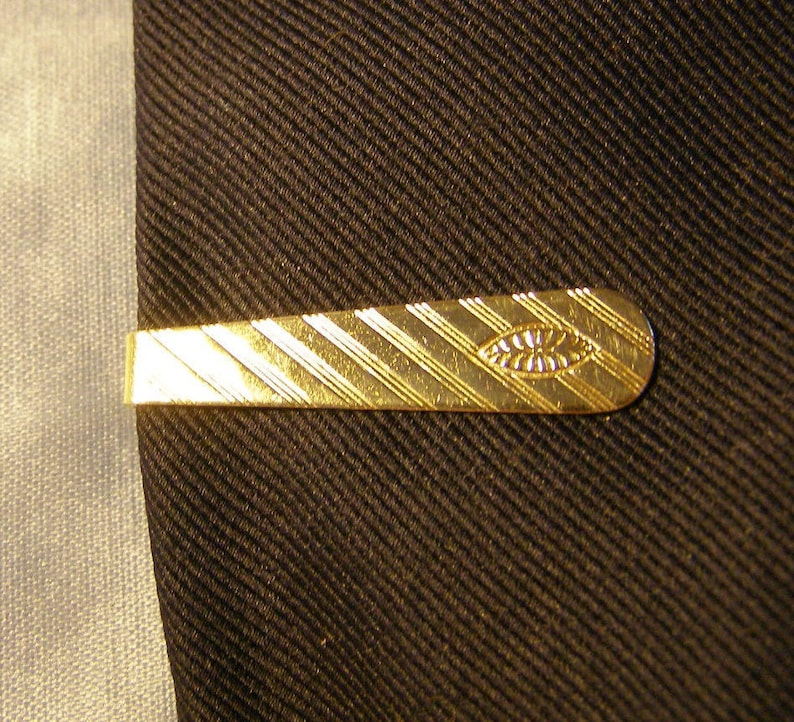 lined w Football shapes Tie Bar etched Evil Eye or Puka Shell design silver plate Tie Clip mens Fashion Jewelry vintage tapered Tie Clip