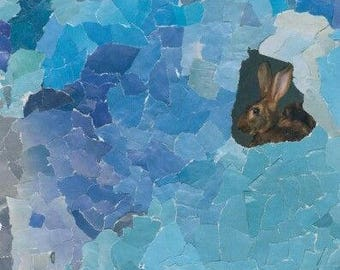 Blue collage with a brown rabbit
