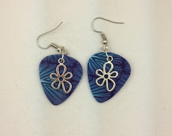 Polymer clay guitar pick shaped earring with funky flower charm
