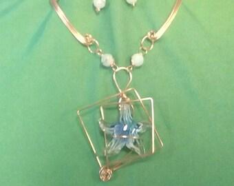 Blue starfish in copper.
