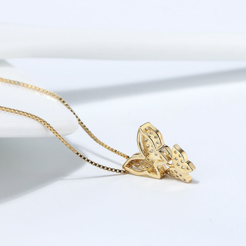 S925 Sterling Silver Pendant Necklace features a Butterfly Motif bedecked with Cubic Zirconia SN191