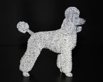 Realistic statue Poodle  of the marble chips